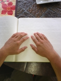 Picture of hands reading Braille