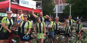 : Group shot of Club VIBES members and volunteers before riding the Tour de Cure